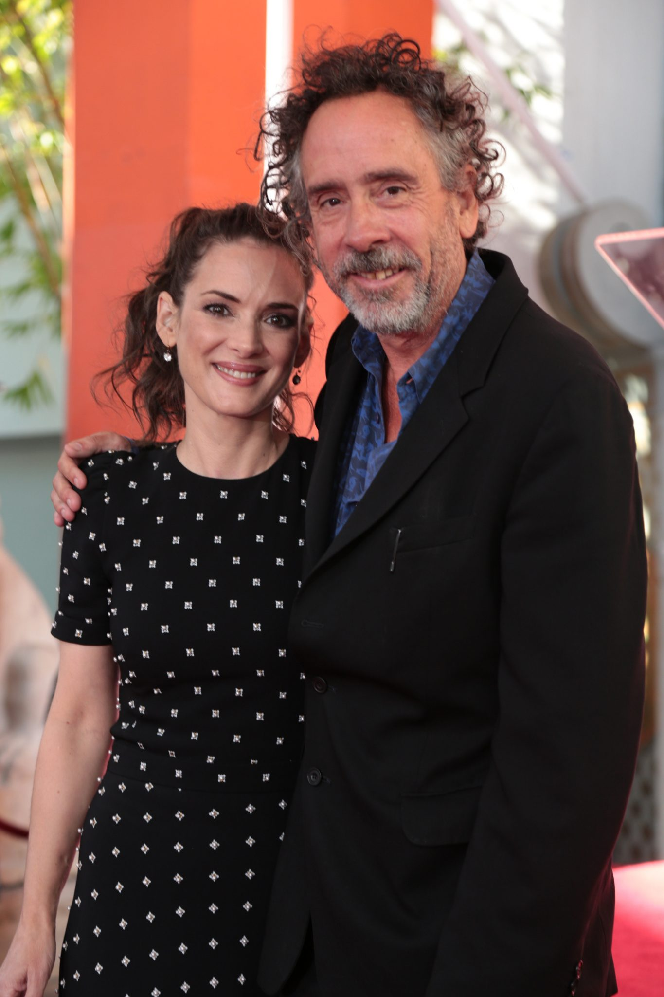 "Winona Ryder celebrates with Tim Burton at his Hand & Footprint Ceremony presented by 20th Century Fox with the release of his newest film ""Miss Peregrine's Home for Peculiar Children"" at the TCL Chinese Theatre in Los Angeles, CA on September 8, 2016. (Photo: Alex J. Berliner/ABImages)"